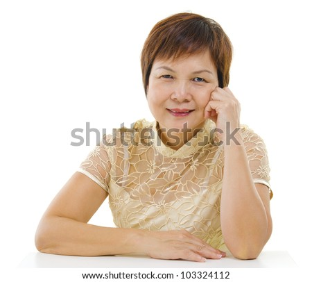 50s mixed race Asian mature woman isolated on white background - stock photo