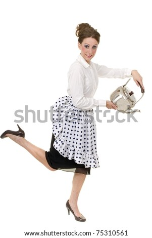 1950s retro housewife pours a kettle - stock photo