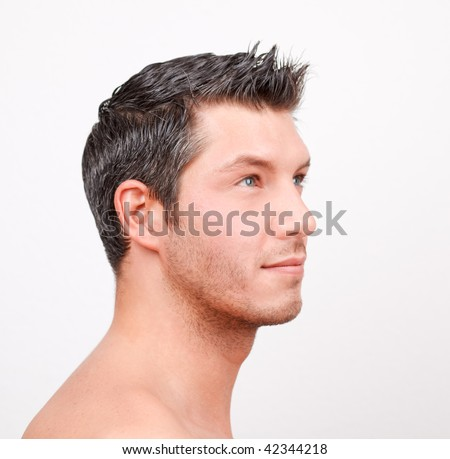 20s 30s caucasian man with brown black hair advertising hairstyle for hairdresser or haircutter - stock photo