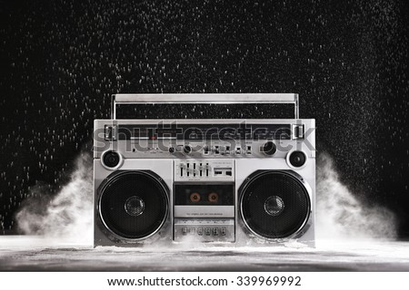 1980s Silver Retro ghetto blaster and dust isolated on black background with clipping path - stock photo