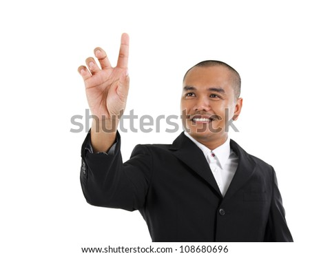 30s southeast Asian business man pointing on transparent virtual screen, space for text/button