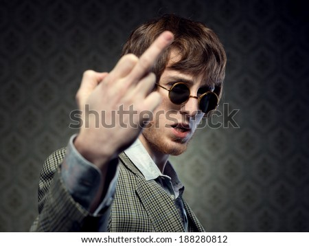 1960s style guy doing the fuck you sign - stock photo