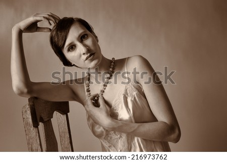 1920's style hair on a nude model. - stock photo