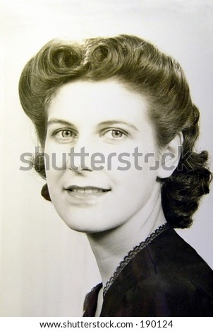1940's woman looking over shoulder. Classic rolled hairstyle, vintage black and white. - stock photo