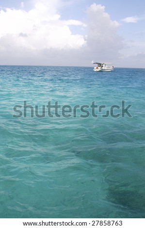sailboat in bright windy ocean - stock photo