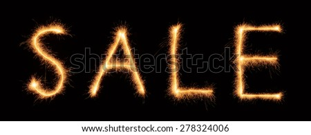 """""""Sale"""" lettering drawn with bengali sparkles isolated on black background - stock photo"""