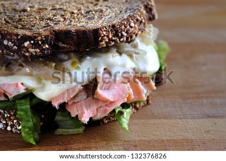 Salmon sandwich on rustic background - stock photo