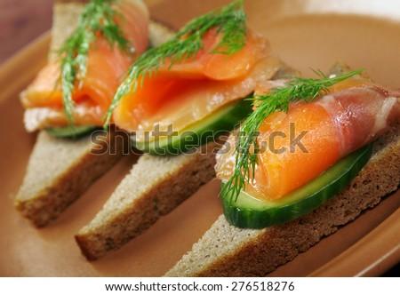 Sandwich with smoked salmon  close up  - stock photo