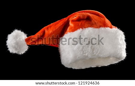 Santa Claus hats on a black background - stock photo
