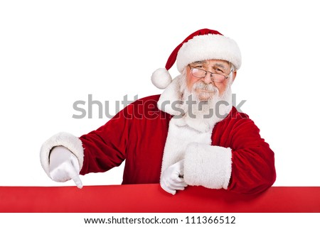 Santa Claus  leaning on big red banner and pointing in it, isolated on white background - stock photo