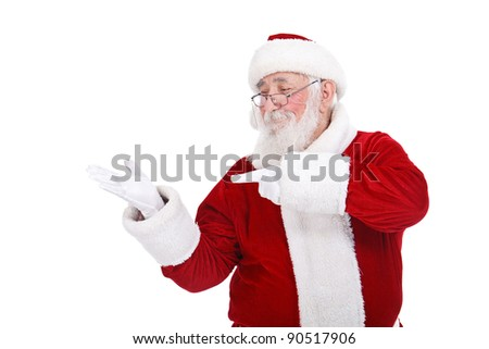 Santa Claus smiling pointing on empty hand,  isolated on white background - stock photo