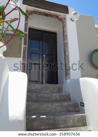 18.06.2015, Santorini, Greece, Vintage house entrance  with brown wood door.