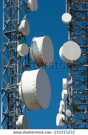 satellite dishes aimed at the sky - stock photo