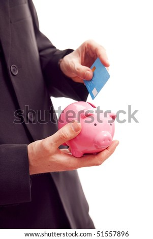 saving money, businessman holding piggy bank and credit card - stock photo