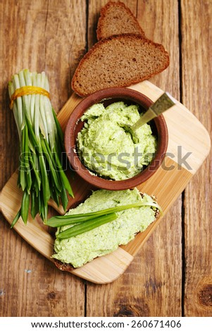 Savory snacks spicy butter with wild garlic - stock photo