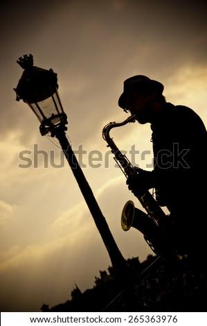 saxophonist in border Seine river in Paris - stock photo