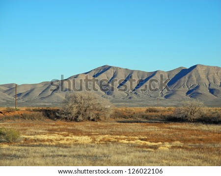Scenic view of the Van Horn mountain range in Texas, with grassland and brush in the mid-ground. - stock photo