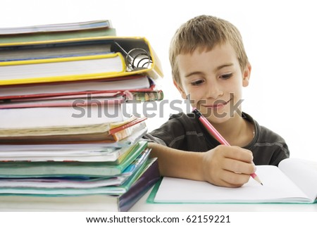 School boy sitting and writing in notebook. Isolated on white