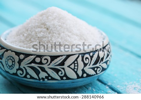 sea salt in a turquoise bowl with a pattern - stock photo
