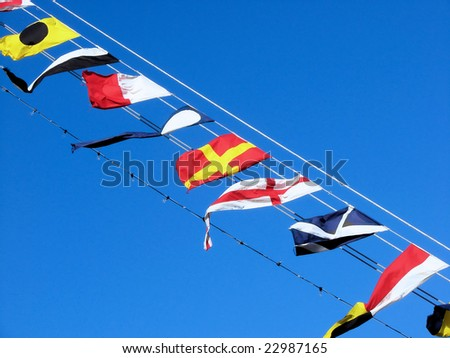 sea ship flags and blue sky