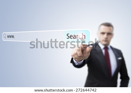 searching system and internet concept - man pressing Search button