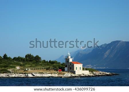 Seascape and lighthouse on the coast near Hvar island, Croatia  - stock photo