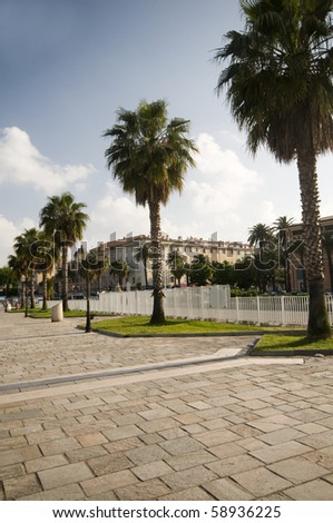 seaside pedestrian walkway promenade with stone tiles and palm trees ajaccio corsica france
