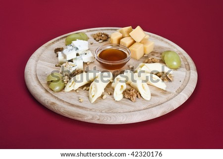 Selection of British Cheeses with Walnuts Biscuits and Grapes - stock photo