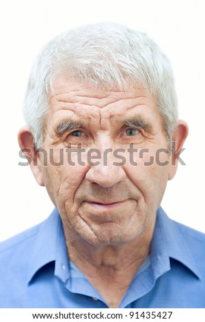 Senior in a blue shirt on a white background