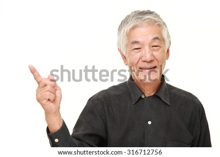 senior Japanese man presenting and showing something