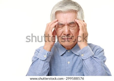 senior Japanese man suffers from headache