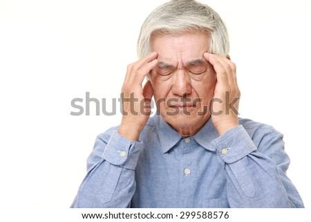 senior Japanese man suffers from headache - stock photo