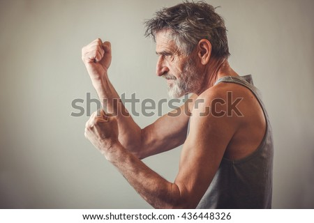 Senior man in fighting position - stock photo
