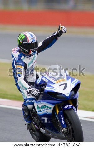27 Sept 2009; Silverstone England: Rider number 7 James Ellison (GBR)  salutes the crowd after winning race 2 of round 11,  at the MCE Insurance British Superbike Championship