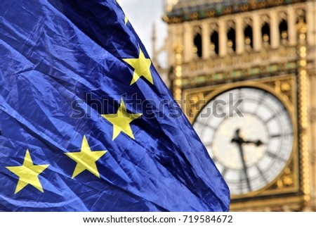 09 September 2017. Westminster, London. The yellow stars on the EU flag partially cover the face of Big Ben in Westminster as talks between the UK and EU stall.