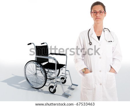 Serious female doctor with a wheelchair on the background