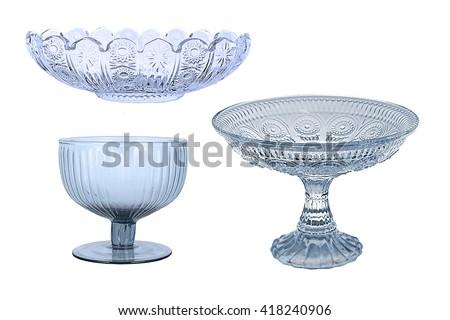 set for the kitchen on a white background Glassware retro old. Crystal transparent utensils. Fruit bowl. vase, glass plate for dessert, serving tea. old, isolated. vintage - stock photo