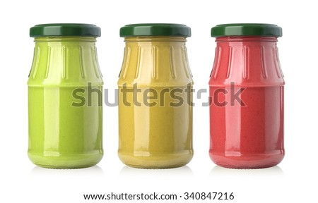 set of sauces in glass jars isolated on white background with clipping path - stock photo