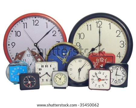 Several  clock faces of different sizes and styles - stock photo