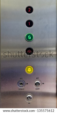 Several stainless steel elevator panel push buttons - stock photo