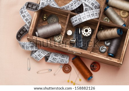 Sewing tools in a wooden box - stock photo