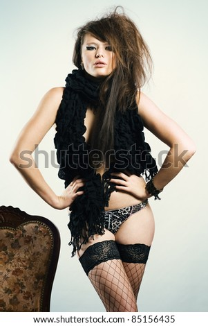 sexy woman in black lingerie over grey background. - stock photo