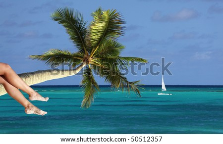 Sexy woman relaxing on tropical beach - stock photo