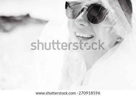 sexy  young beautiful girl  in sunglasses and white clothes on their honeymoon in Cyprus on the beach - stock photo