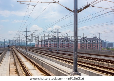 08/10/2016 Shanrao,China Straight rail tracks and Chinese buildings in the background and a train in the distance