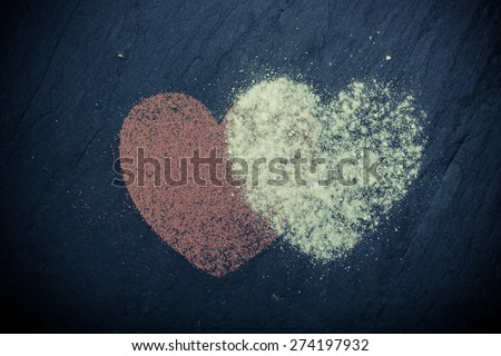 shapes of hearts from Cinnamon  on stones background - stock photo