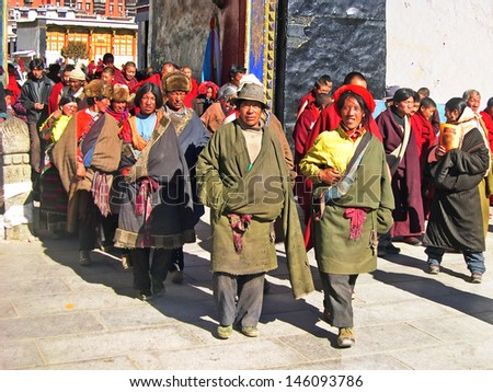 SHIGATSE, TIBET-NOVEMBER 16: monks and pilgrims exit Tashilhumpo  monastery. Founded in 1447 it is one of the most important monastery in Tibet. November 16, 2004 Shigatse, Tibet