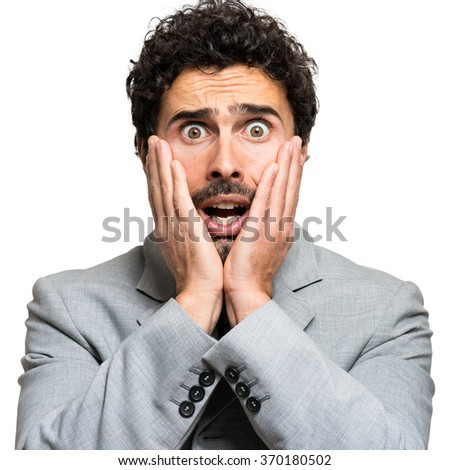 Shocked businessman portrait - stock photo