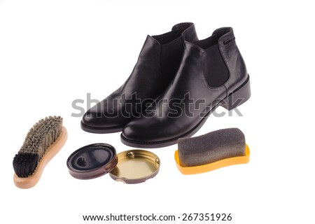 shoes and wax isolated over white background - stock photo