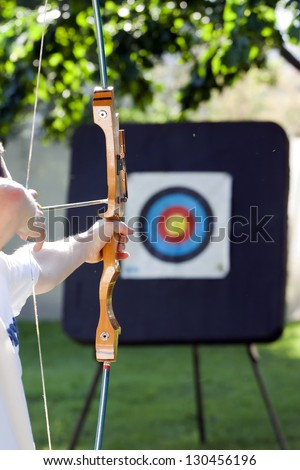 shooting to the archery target - stock photo